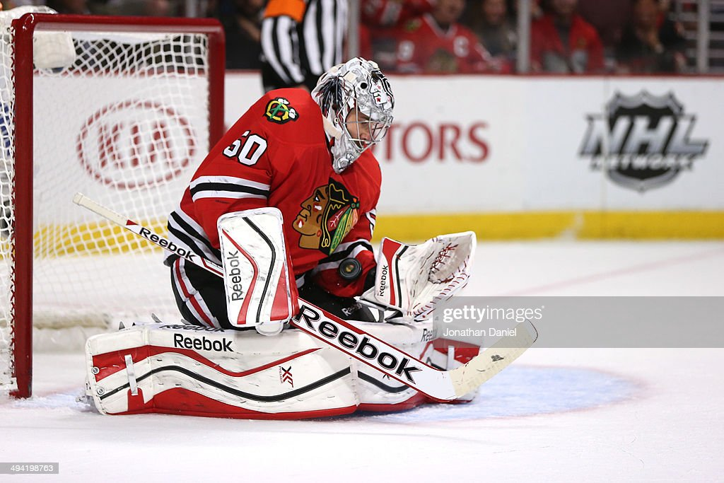 <a gi-track='captionPersonalityLinkClicked' href=/galleries/search?phrase=Corey+Crawford&family=editorial&specificpeople=818935 ng-click='$event.stopPropagation()'>Corey Crawford</a> #50 of the Chicago Blackhawks makes a save against the Los Angeles Kings in the first period during Game Five of the Western Conference Final in the 2014 Stanley Cup Playoffs at United Center on May 28, 2014 in Chicago, Illinois.