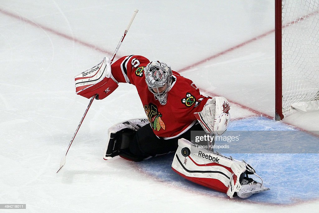 <a gi-track='captionPersonalityLinkClicked' href=/galleries/search?phrase=Corey+Crawford&family=editorial&specificpeople=818935 ng-click='$event.stopPropagation()'>Corey Crawford</a> #50 of the Chicago Blackhawks makes a save against the Los Angeles Kings during Game Five of the Western Conference Final in the 2014 Stanley Cup Playoffs at United Center on May 28, 2014 in Chicago, Illinois.