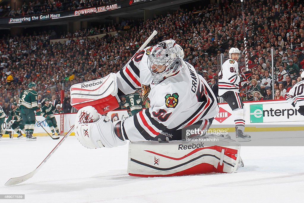 Corey Crawford #50 of the Chicago Blackhawks makes a save against the Minnesota Wild during Game Four of the Second Round of the 2014 Stanley Cup Playoffs on May 9, 2014 at the Xcel Energy Center in St. Paul, Minnesota.