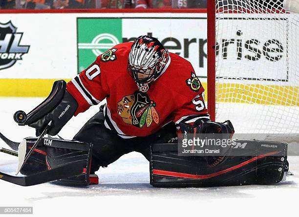 Corey Crawford of the Chicago Blackhawks makes a save against the Montreal Canadiens at the United Center on January 17 2016 in Chicago Illinois