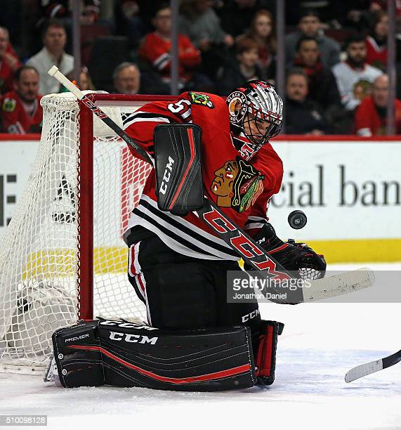 Corey Crawford of the Chicago Blackhawks makes a save against the Anaheim Ducks at the United Center on February 13 2016 in Chicago Illinois
