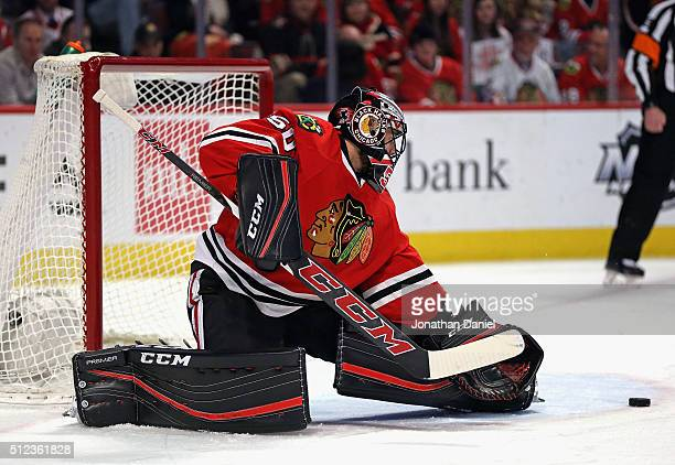 Corey Crawford of the Chicago Blackhawks makes a save against the Nashville Predators at the United Center on February 25 2016 in Chicago Illinois