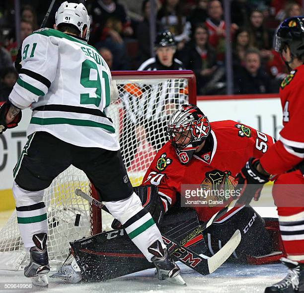 Corey Crawford of the Chicago Blackhawks makes a save against Tyler Seguin of the Dallas Stars at the United Center on February 11 2016 in Chicago...