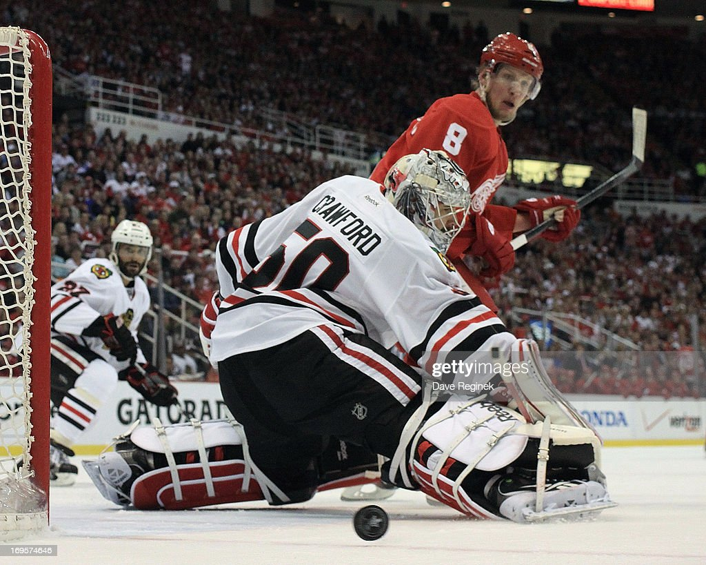 <a gi-track='captionPersonalityLinkClicked' href=/galleries/search?phrase=Corey+Crawford&family=editorial&specificpeople=818935 ng-click='$event.stopPropagation()'>Corey Crawford</a> #50 of the Chicago Blackhawks makes a save as <a gi-track='captionPersonalityLinkClicked' href=/galleries/search?phrase=Justin+Abdelkader&family=editorial&specificpeople=2271858 ng-click='$event.stopPropagation()'>Justin Abdelkader</a> #8 of the Detroit Red Wings looks for the rebound during Game Six of the Western Conference Semifinals during the 2013 NHL Stanley Cup Playoffs at Joe Louis Arena on May 27, 2013 in Detroit, Michigan. Chicago won 4-2