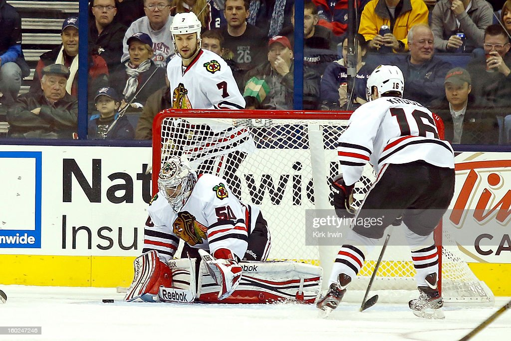 Corey Crawford #50 of the Chicago Blackhawks makes a save during the game against the Columbus Blue Jackets on January 26, 2013 at Nationwide Arena in Columbus, Ohio.
