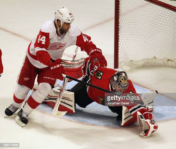 Corey Crawford of the Chicago Blackhawks makes a save in the closing minute as Todd Bertuzzi of the Detroit Red Wings moves in at the United Center...