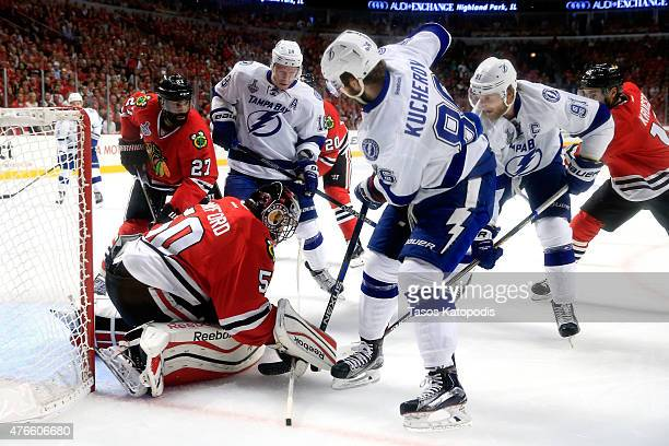 Corey Crawford of the Chicago Blackhawks makes a save in the first period against Nikita Kucherov of the Tampa Bay Lightning during Game Four of the...