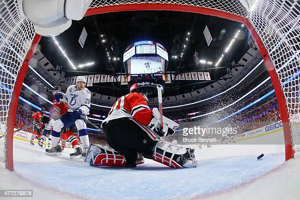 Corey Crawford of the Chicago Blackhawks makes a save in the first period against the Tampa Bay Lightning during Game Six of the 2015 NHL Stanley Cup...