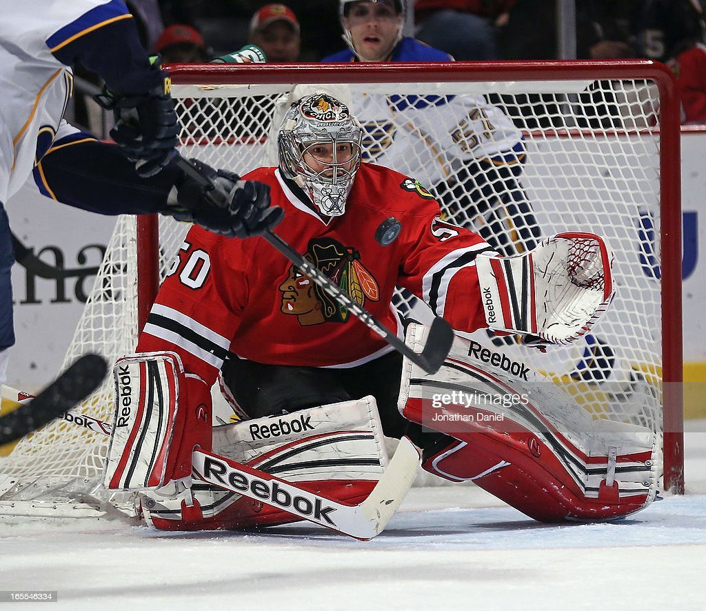 Corey Crawford #50 of the Chicago Blackhawks makes a save on a shot by Valdimir Tarasenko #91 of the St. Louis Blues at the United Center on April 4, 2013 in Chicago, Illinois.