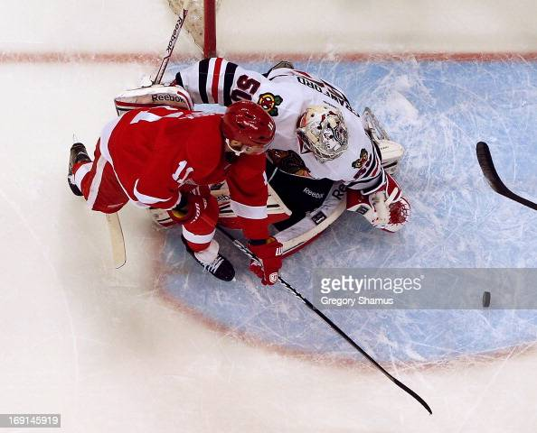 Corey Crawford of the Chicago Blackhawks makes a save on a shot by Daniel Cleary of the Detroit Red Wings in Game Three of the Western Conference...