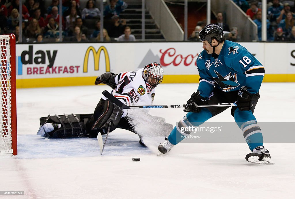Corey Crawford #50 of the Chicago Blackhawks makes a save on a shot taken by Mike Brown #18 of the San Jose Sharks at SAP Center on November 25, 2015 in San Jose, California.