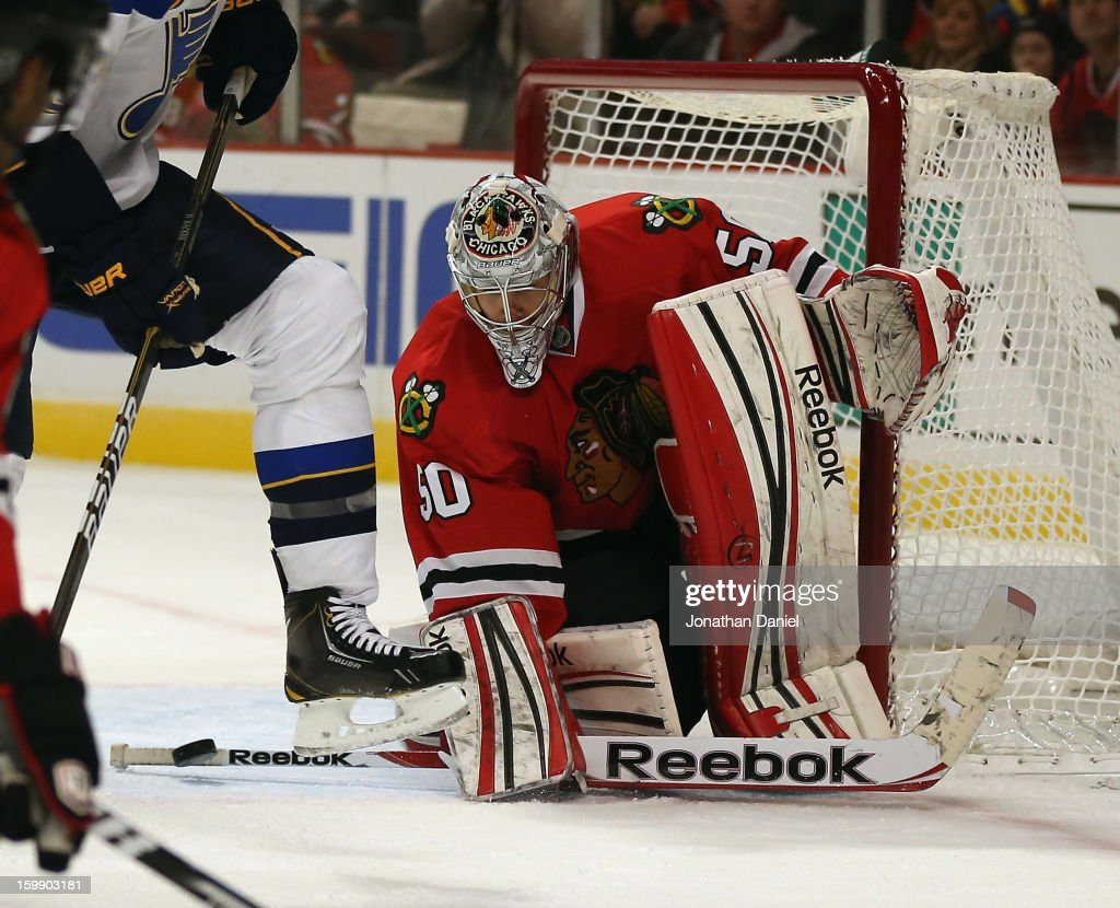 Corey Crawford #50 of the Chicago Blackhawks makes a stick save against the St. Louis Blues at the United Center on January 22, 2013 in Chicago, Illinois. The Blackhawks defeated the Blues 3-2.