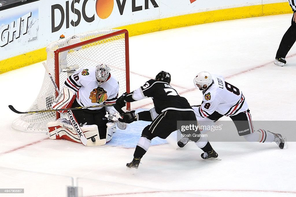 Corey Crawford #50 of the Chicago Blackhawks makes the save against Dustin Brown #23 of the Los Angeles Kings in Game Six of the Western Conference Final during the 2014 Stanley Cup Playoffs at Staples Center on May 30, 2014 in Los Angeles, California.