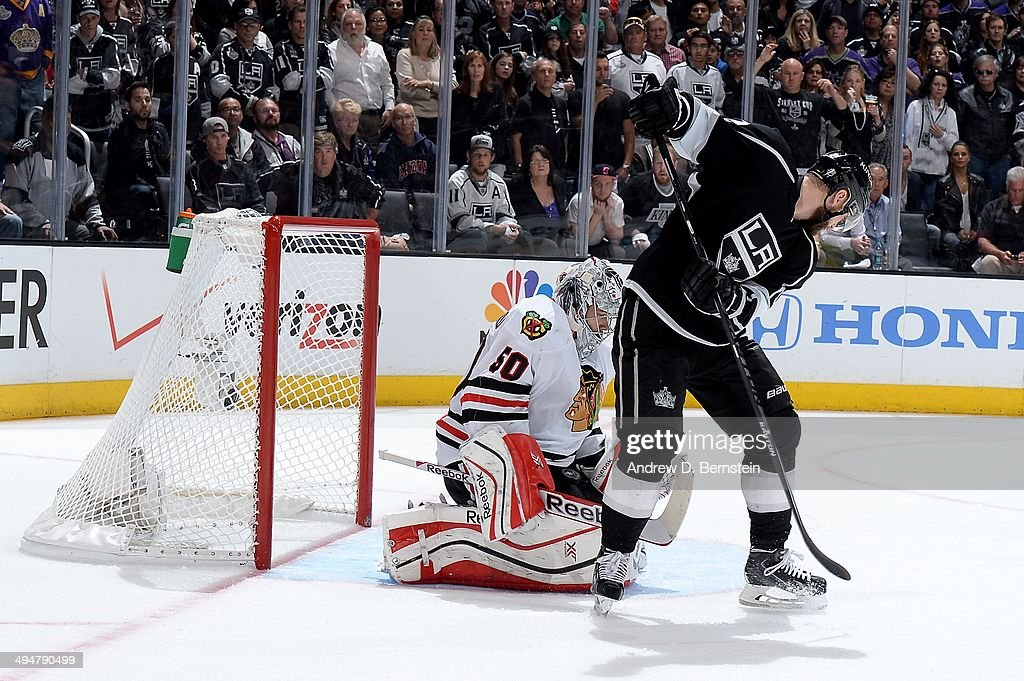 Corey Crawford #30 of the Chicago Blackhawks makes the save against the Los Angeles Kings in Game Six of the Western Conference Final during the 2014 Stanley Cup Playoffs at Staples Center on May 30, 2014 in Los Angeles, California.