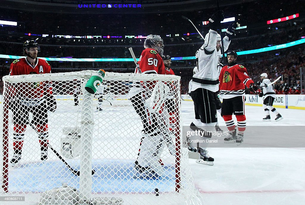 <a gi-track='captionPersonalityLinkClicked' href=/galleries/search?phrase=Corey+Crawford&family=editorial&specificpeople=818935 ng-click='$event.stopPropagation()'>Corey Crawford</a> #50 of the Chicago Blackhawks reacts after Drew Doughty #8 of the Los Angeles Kings scored a goal in the third period of Game Two of the Western Conference Final during the 2014 Stanley Cup Playoffs at United Center on May 21, 2014 in Chicago, Illinois.