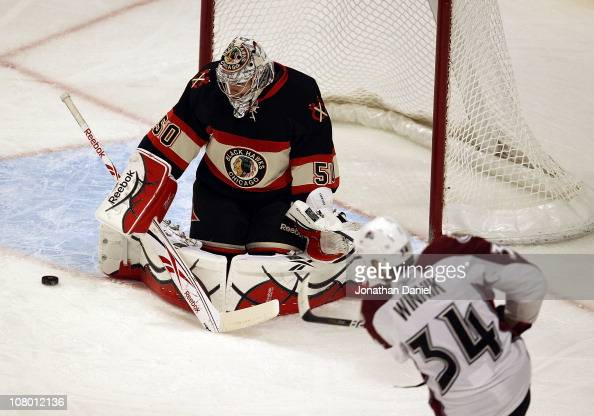 Corey Crawford of the Chicago Blackhawks rejects a shot by Daniel Winnik of the Colorado Avalanche at the United Center on January 12 2011 in Chicago...