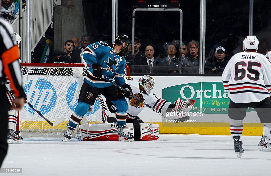 Corey Crawford #50 of the Chicago Blackhawks saves a shot against Joe Thornton #19 of the San Jose Sharks at the HP Pavilion on February 5, 2013 in San Jose, California. The Blackhawks defeated the Sharks 5-3.