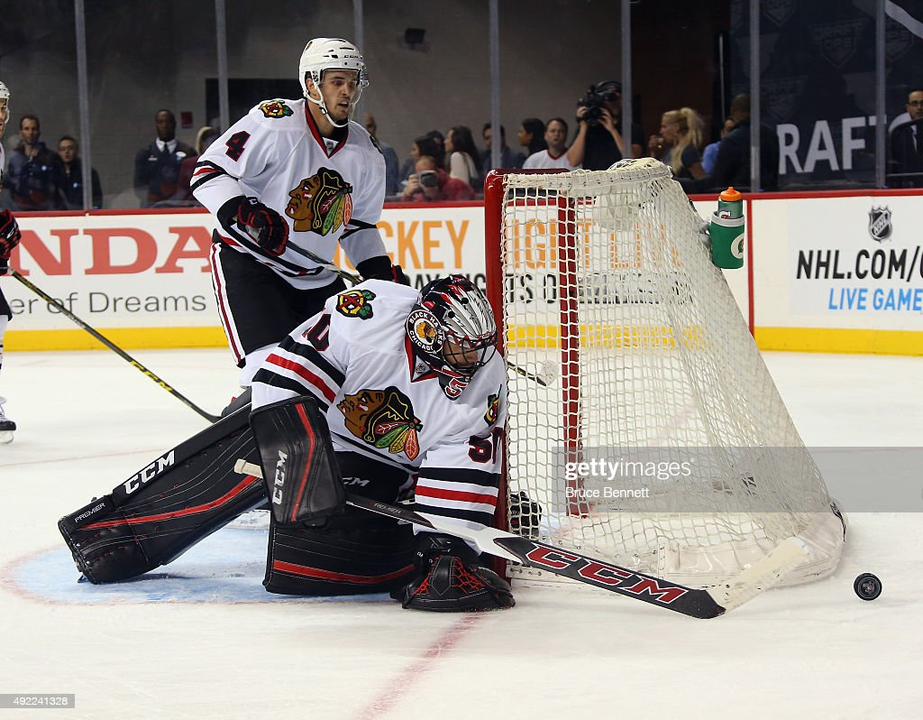 Corey Crawford #50 of the Chicago Blackhawks skates against the New York Islanders at the Barclays Center on October 9, 2015 in Brooklyn borough of New York City. The game is the first for the Islanders in their new arena. The Blackhawks defeated the Islanders 3-2 in overtime.