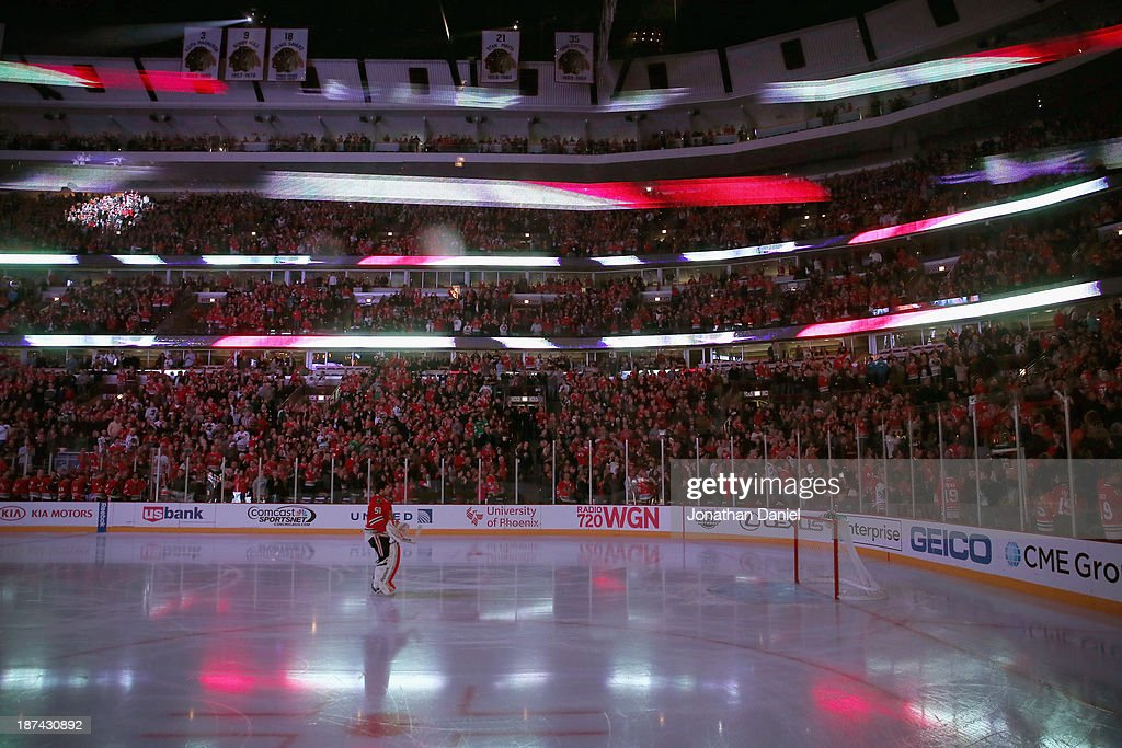 Corey Crawford #50 of the Chicago Blackhawks stands during the National Anthem before a game against the Calgary Flames at the United Center on November 3, 2013 in Chicago, Illinois. The Flames defeated the Blackhawks 3-2 in overtime.