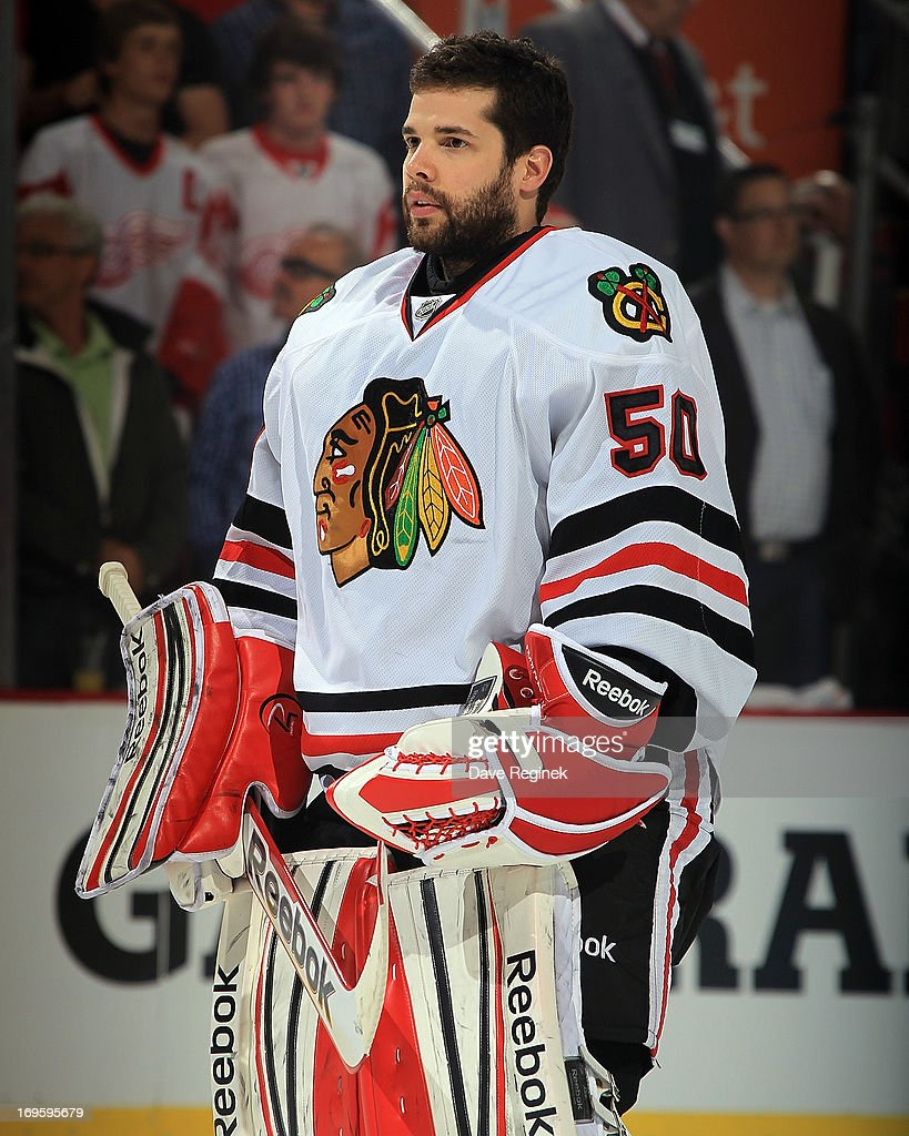 Corey Crawford #50 of the Chicago Blackhawks stands for the National Anthem against the Detroit Red Wings before Game Four of the Western Conference Semifinals during the 2013 NHL Stanley Cup Playoffs at Joe Louis Arena on May 23, 2013 in Detroit, Michigan. The Wings won 2-0