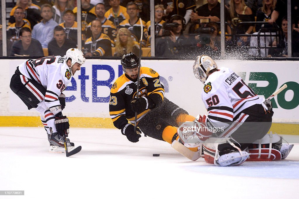 Corey Crawford of the Chicago Blackhawks stops a shot by Chris Kelly of the Boston Bruins in Game Three of the 2013 NHL Stanley Cup Final at TD...