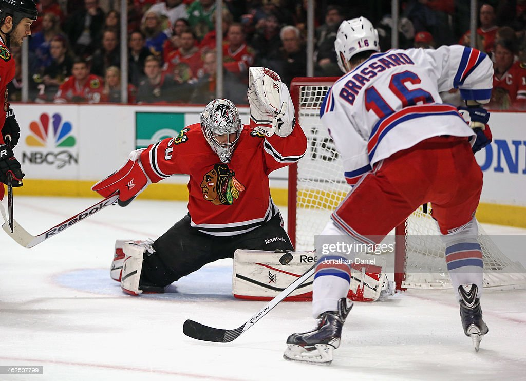 <a gi-track='captionPersonalityLinkClicked' href=/galleries/search?phrase=Corey+Crawford&family=editorial&specificpeople=818935 ng-click='$event.stopPropagation()'>Corey Crawford</a> #50 of the Chicago Blackhawks stops a shot by <a gi-track='captionPersonalityLinkClicked' href=/galleries/search?phrase=Derick+Brassard&family=editorial&specificpeople=540468 ng-click='$event.stopPropagation()'>Derick Brassard</a> #16 of the New York Rangers at the United Center on January 8, 2014 in Chicago, Illinois. The Rangers defeated the Blackhawks 3-2.