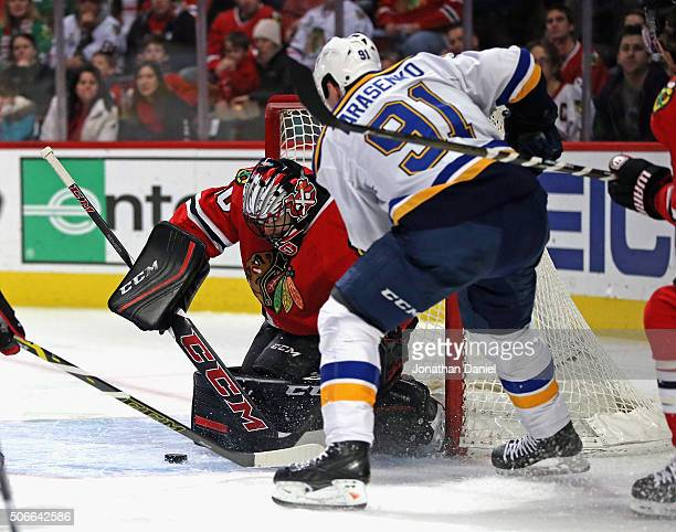 Corey Crawford of the Chicago Blackhawks stops a shot by Vladimir Tarasenko of the St Louis Blues at the United Center on January 24 2016 in Chicago...