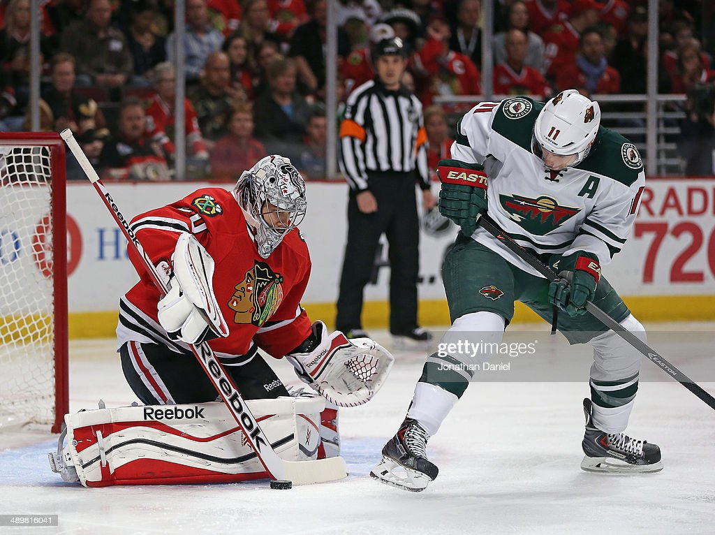 <a gi-track='captionPersonalityLinkClicked' href=/galleries/search?phrase=Corey+Crawford&family=editorial&specificpeople=818935 ng-click='$event.stopPropagation()'>Corey Crawford</a> #50 of the Chicago Blackhawks stops a shot by <a gi-track='captionPersonalityLinkClicked' href=/galleries/search?phrase=Zach+Parise&family=editorial&specificpeople=213606 ng-click='$event.stopPropagation()'>Zach Parise</a> #11 of the Minnesota Wild in Game Five of the Second Round of the 2014 NHL Stanley Cup Playoffs at the United Center on May 11, 2014 in Chicago, Illinois. The Blackhawks defeated the Wild 2-1.