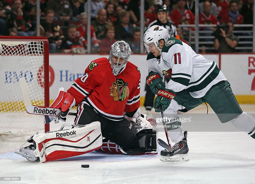 Corey Crawford #50 of the Chicago Blackhawks stops a shot by Zach Parise #11 of the Minnesota Wild in Game Five of the Second Round of the 2014 NHL Stanley Cup Playoffs at the United Center on May 11, 2014 in Chicago, Illinois. The Blackhawks defeated the Wild 2-1.