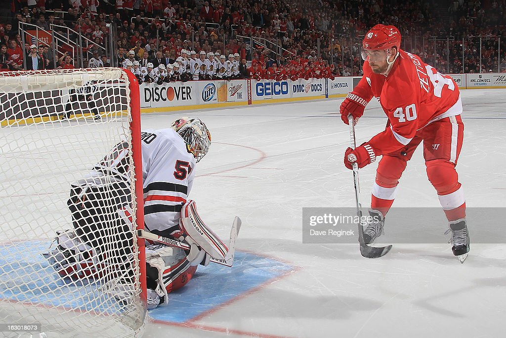 <a gi-track='captionPersonalityLinkClicked' href=/galleries/search?phrase=Corey+Crawford&family=editorial&specificpeople=818935 ng-click='$event.stopPropagation()'>Corey Crawford</a> #50 of the Chicago Blackhawks stops <a gi-track='captionPersonalityLinkClicked' href=/galleries/search?phrase=Henrik+Zetterberg&family=editorial&specificpeople=201520 ng-click='$event.stopPropagation()'>Henrik Zetterberg</a> #40 of the Detroit Red Wings on a shoot out attempt during an NHL game at Joe Louis Arena on March 3, 2013 in Detroit, Michigan. Chicago won 2-1