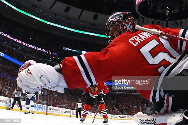 Corey Crawford of the Chicago Blackhawks stretches to make a save in the third period against the Tampa Bay Lightning during Game Four of the 2015...