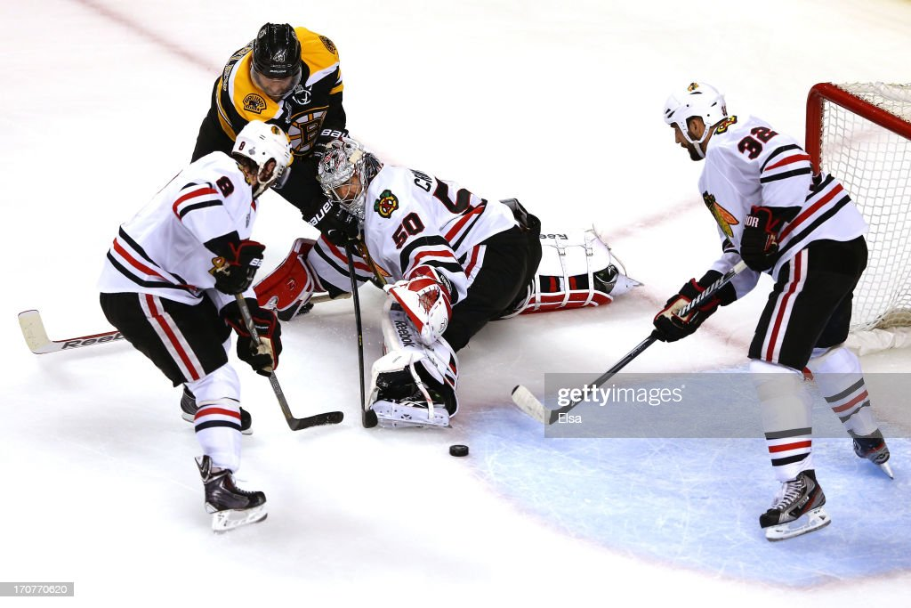 <a gi-track='captionPersonalityLinkClicked' href=/galleries/search?phrase=Corey+Crawford&family=editorial&specificpeople=818935 ng-click='$event.stopPropagation()'>Corey Crawford</a> #50 of the Chicago Blackhawks tends goal against <a gi-track='captionPersonalityLinkClicked' href=/galleries/search?phrase=Rich+Peverley&family=editorial&specificpeople=554442 ng-click='$event.stopPropagation()'>Rich Peverley</a> #49 of the Boston Bruins in Game Three of the 2013 NHL Stanley Cup Final at TD Garden on June 17, 2013 in Boston, Massachusetts.