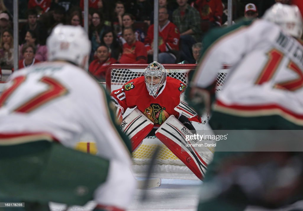 Corey Crawford #50 of the Chicago Blackhawks watches the action in front of him against the Minnesota Wild at the United Center on March 5, 2013 in Chicago, Illinois.