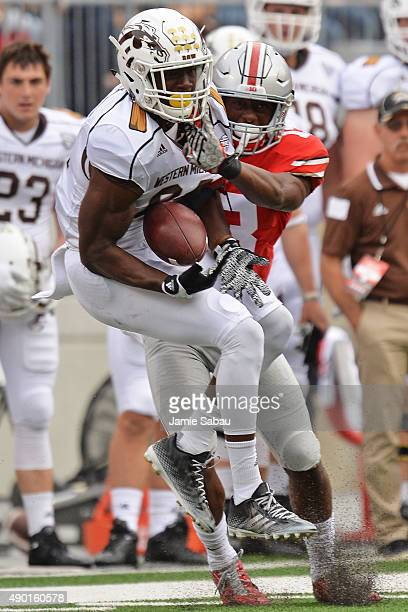 Corey Davis of the Western Michigan Broncos corrals a pass for a short gain in front of Eli Apple of the Ohio State Buckeyes in the first quarter at...