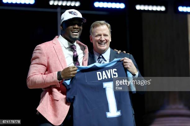 Corey Davis of Western Michigan poses with Commissioner of the National Football League Roger Goodell after being picked overall by the Tennessee...
