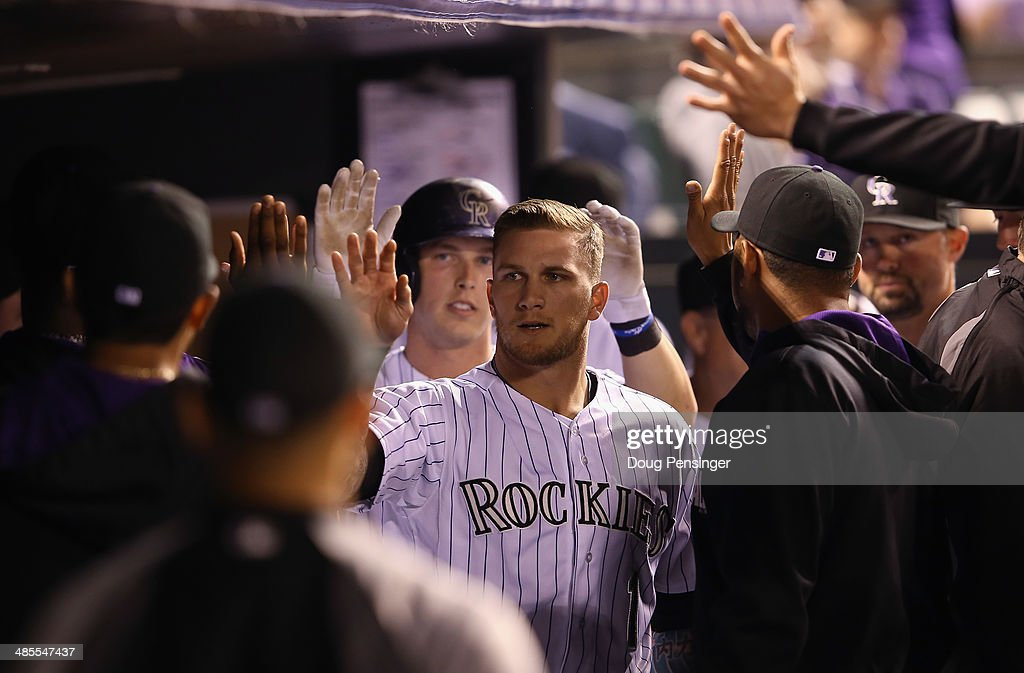 Corey Dickerson #6 and Brandon Barnes #1 of the Colorado Rockies celebrate after scoring on a double by <a gi-track='captionPersonalityLinkClicked' href=/galleries/search?phrase=Wilin+Rosario&family=editorial&specificpeople=5734314 ng-click='$event.stopPropagation()'>Wilin Rosario</a> #20 of the Colorado Rockies off of B.J. Rosenberg #39 of the Philadelphia Phillies to give the Rockies a 12-1 lead in the eighth inning at Coors Field on April 18, 2014 in Denver, Colorado.