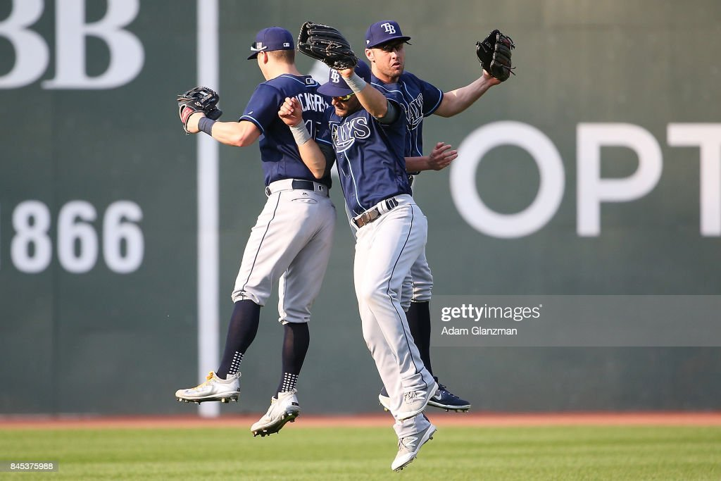 Corey Dickerson #10, Kevin Kiermaier #39 and Peter Bourjos #18 of the Tampa Bay Rays react after a victory over the Boston Red Sox at Fenway Park on September 10, 2017 in Boston, Massachusetts.