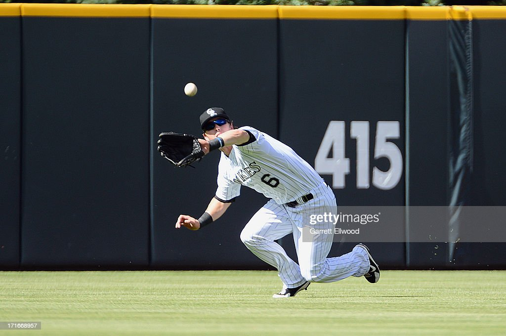 Corey Dickerson #6 of the Colorado Rockies catches a fly ball against the New York Mets in the second inning of the game at Coors Field on June 27, 2013 in Denver, Colorado. Photo by Garrett W. Ellwood/Getty Images)