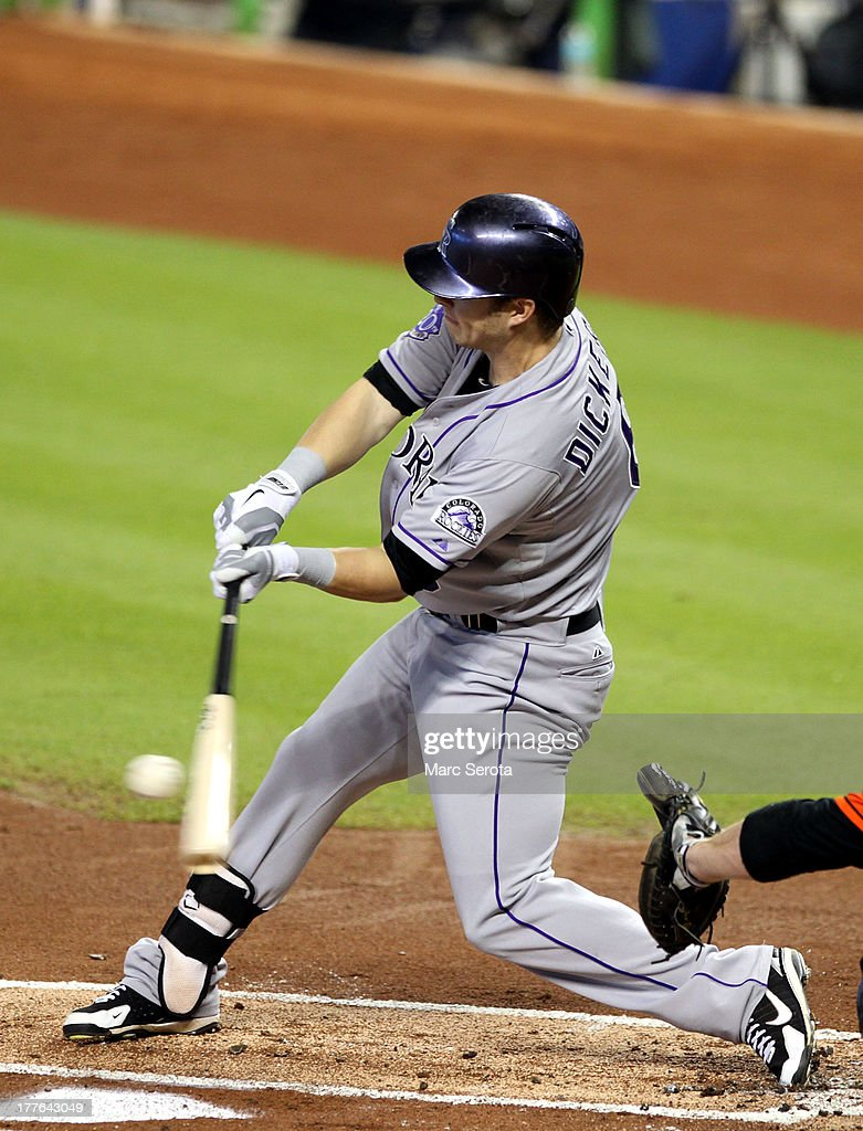 Corey Dickerson #6 of the Colorado Rockies drives in a run against the Miami Marlins at Marlins Park on August 25, 2013 in Miami, Florida.