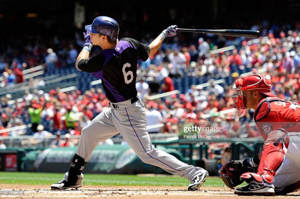 Corey Dickerson #6 of the Colorado Rockies hits a RBI double in the first inning during a game against the Washington Nationals at Nationals Park on June 22, 2013 in Washington, DC.