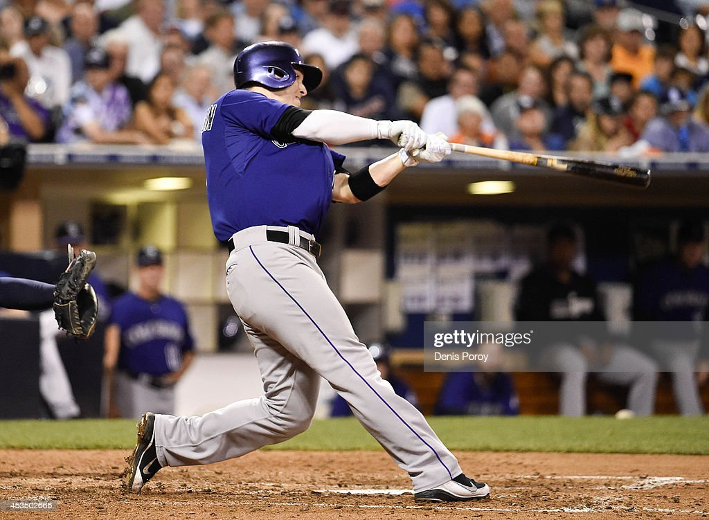 Corey Dickerson #6 of the Colorado Rockies hits a three run home run during the sixth inning of a baseball game against the San Diego Padres at Petco Park August, 11, 2014 in San Diego, California.
