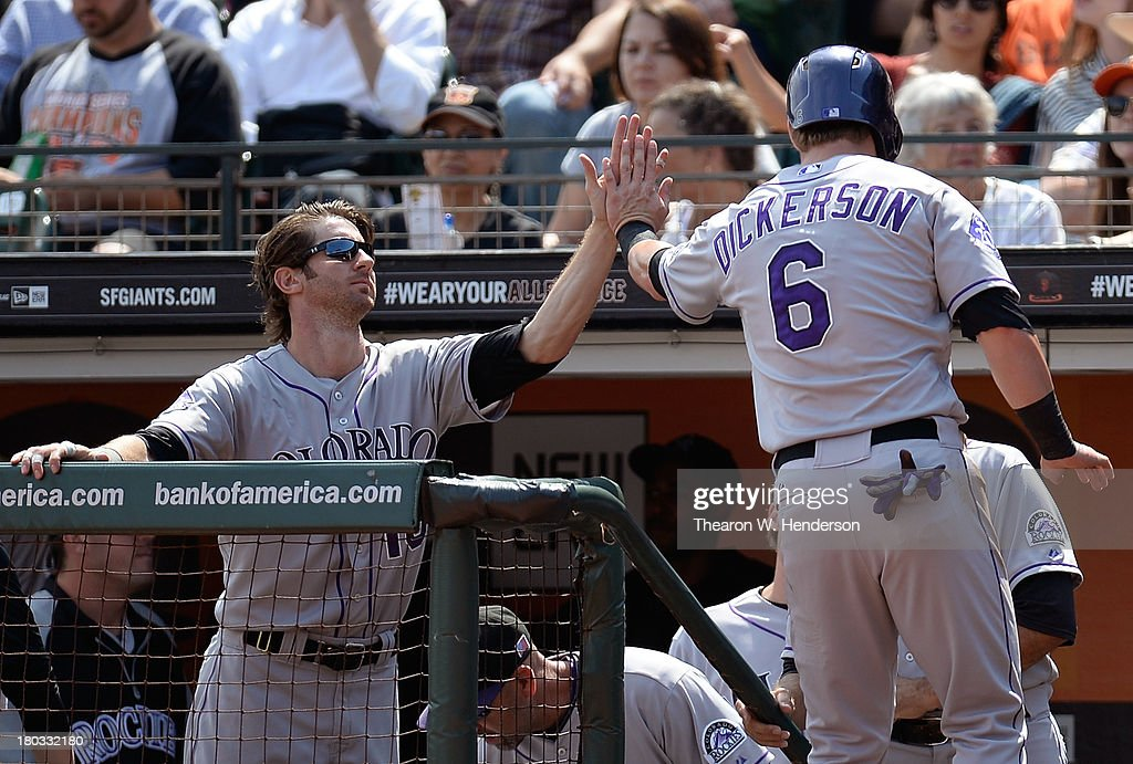 Corey Dickerson #6 of the Colorado Rockies is congratulated by Charlie Blackmon #19 after Dickerson scored during the fourth inning against the San Francisco Giants at AT&T Park on September 11, 2013 in San Francisco, California.