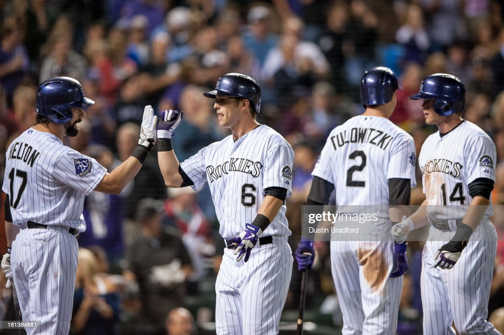Corey Dickerson #6 of the Colorado Rockies is congratulated by teammate <a gi-track='captionPersonalityLinkClicked' href=/galleries/search?phrase=Todd+Helton&family=editorial&specificpeople=200735 ng-click='$event.stopPropagation()'>Todd Helton</a> #17 as <a gi-track='captionPersonalityLinkClicked' href=/galleries/search?phrase=Troy+Tulowitzki&family=editorial&specificpeople=757353 ng-click='$event.stopPropagation()'>Troy Tulowitzki</a> #2 and <a gi-track='captionPersonalityLinkClicked' href=/galleries/search?phrase=Josh+Rutledge&family=editorial&specificpeople=9541486 ng-click='$event.stopPropagation()'>Josh Rutledge</a> #14 of the Rockies also celebrate a sixth-inning two-run home run hit by Dickerson against the Arizona Diamondbacks at Coors Field on September 20, 2013 in Denver, Colorado.