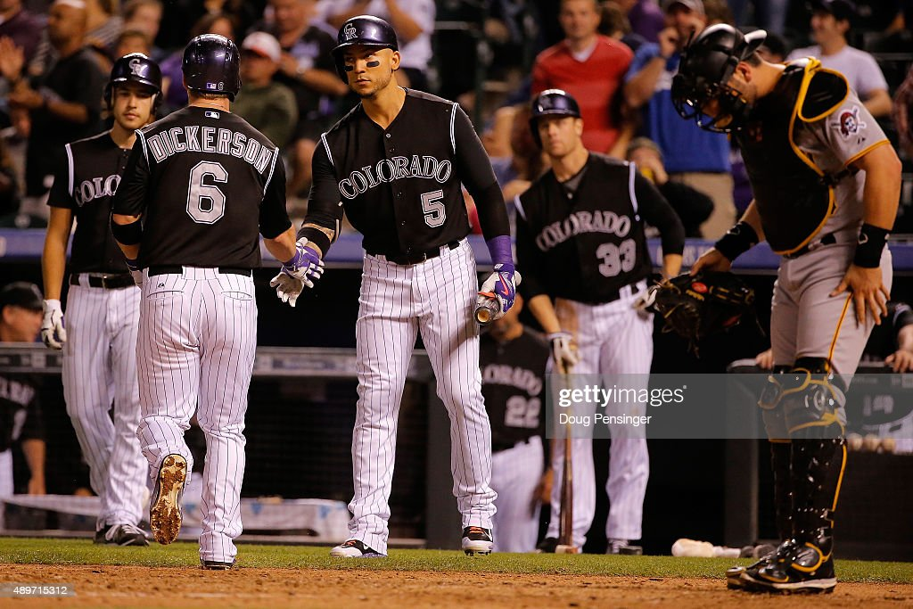 Corey Dickerson #6 of the Colorado Rockies is welcomed home by <a gi-track='captionPersonalityLinkClicked' href=/galleries/search?phrase=Carlos+Gonzalez+-+Amerikansk+basebollspelare&family=editorial&specificpeople=7204259 ng-click='$event.stopPropagation()'>Carlos Gonzalez</a> #5 of the Colorado Rockies after his solo home run off of starting pitcher Charlie Morton #50 of the Pittsburgh Pirates as the Pirates held a 7-3 lead in the fifth inning at Coors Field on September 23, 2015 in Denver, Colorado.