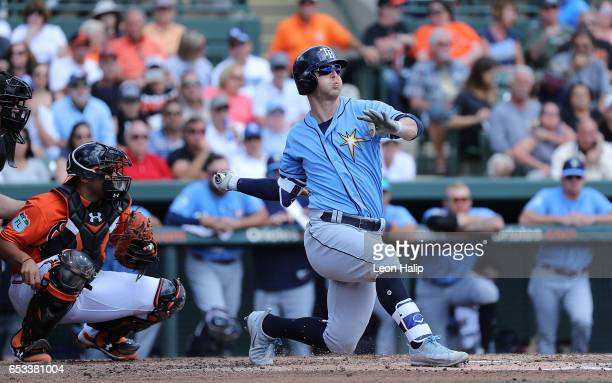 Corey Dickerson of the Tampa Bay Rays bats in the second inning of the Spring Training Game against the Baltimore Orioles on March 14 2017 at Ed...