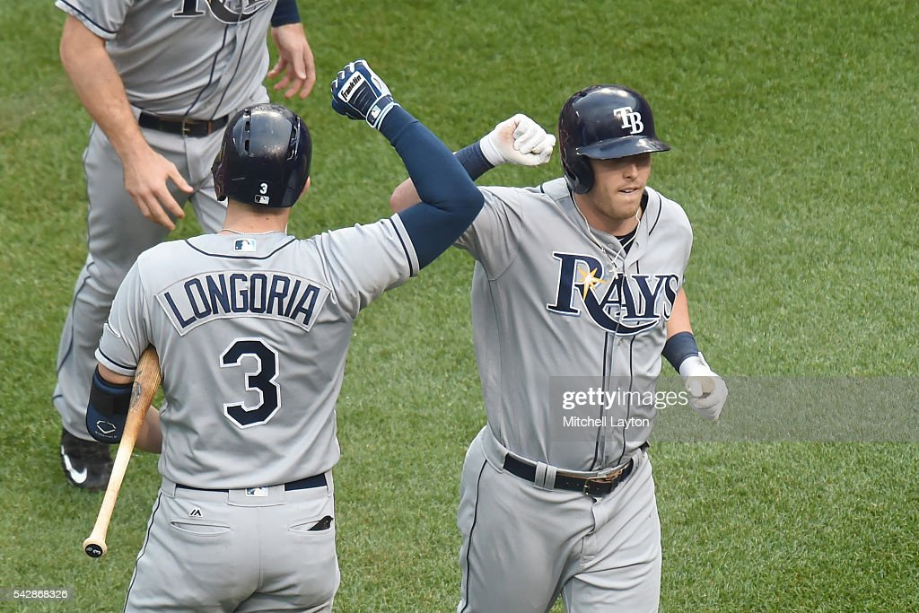 <a gi-track='captionPersonalityLinkClicked' href=/galleries/search?phrase=Corey+Dickerson+-+Baseball+Left+Fielder&family=editorial&specificpeople=15425201 ng-click='$event.stopPropagation()'>Corey Dickerson</a> #10 of the Tampa Bay Rays celebrates a two run home run in the first inning with <a gi-track='captionPersonalityLinkClicked' href=/galleries/search?phrase=Evan+Longoria&family=editorial&specificpeople=2349329 ng-click='$event.stopPropagation()'>Evan Longoria</a> #3 during a baseball game against the Baltimore Orioles at Oriole Park at Camden Yards on June 24, 2016 in Baltimore, Maryland.