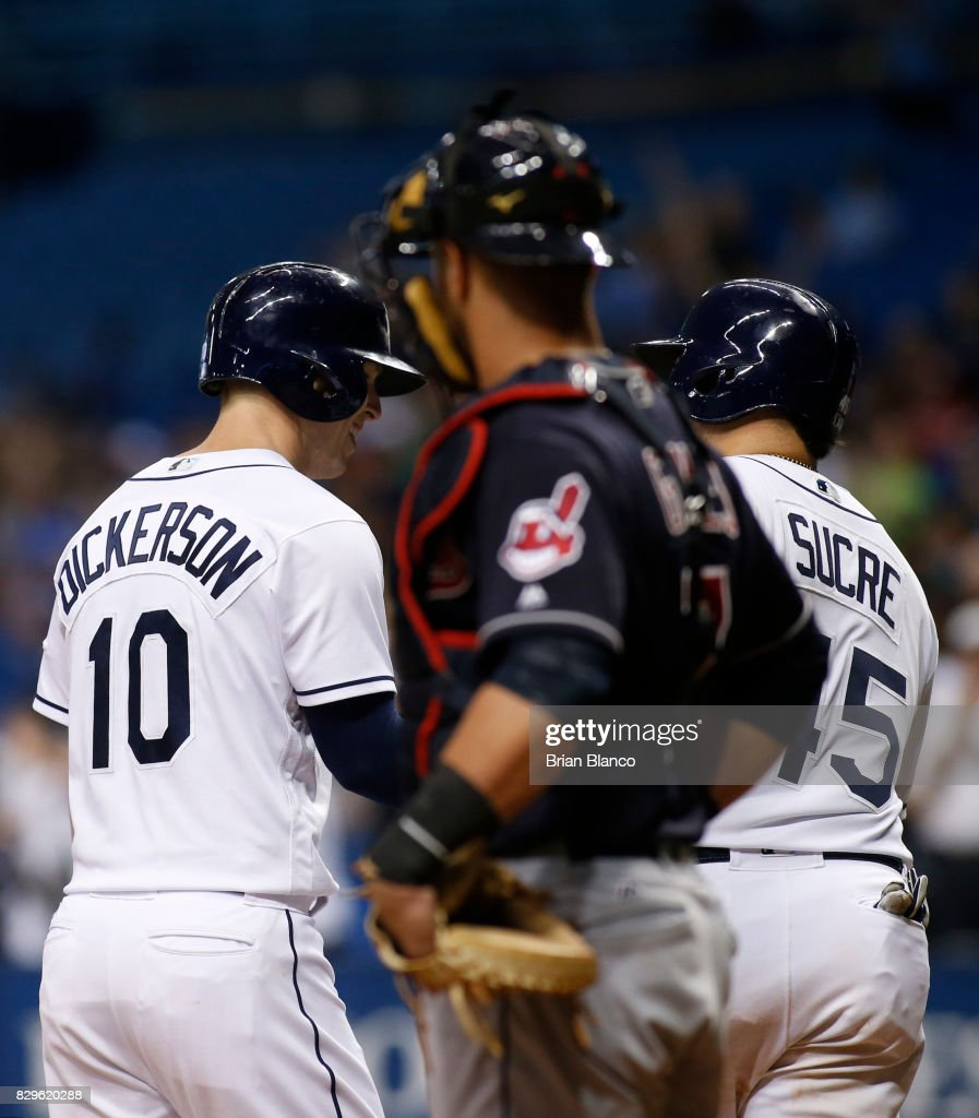 Corey Dickerson #10 of the Tampa Bay Rays celebrates with teammate Jesus Sucre #45 in front of catcher Yan Gomes #7 of the Cleveland Indians after hitting a three-run home run off of pitcher Nick Goody of the Cleveland Indians during the eighth inning of a game on August 10, 2017 at Tropicana Field in St. Petersburg, Florida.