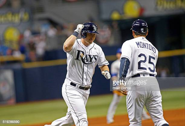 Corey Dickerson of the Tampa Bay Rays celebrates with third base coach Charlie Montoyo after hitting a home run off of pitcher Aaron Sanchez of the...