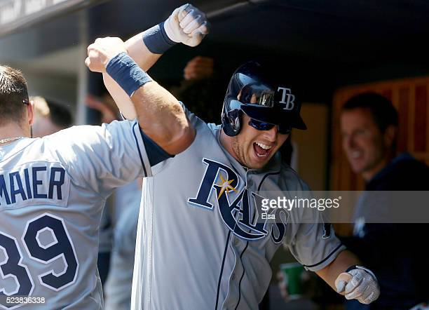 Corey Dickerson of the Tampa Bay Rays celerates his home run with teammates in the dugout during the first inning against the New York Yankees at...