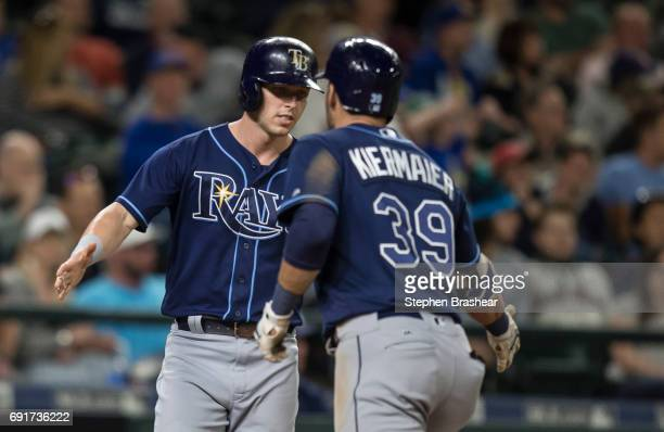 Corey Dickerson of the Tampa Bay Rays congratulates Kevin Kiermaier of the Tampa Bay Rays after Kiermaier hit a tworun home run off of relief pitcher...